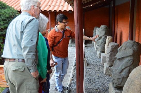 Mirko shows my parents huacas in the museum garden