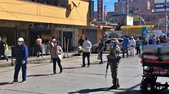 Soldiers guarding market entrance