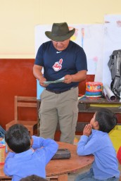 Ade reading to schoolkids